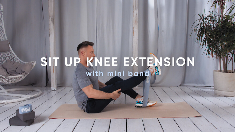 Sit up knee extension with mini band