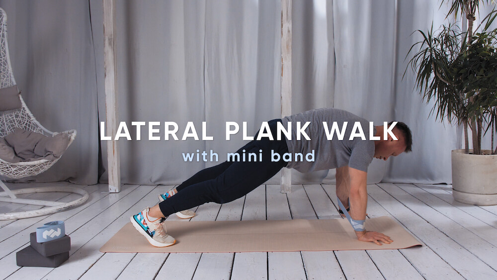 Lateral plank walk with mini band
