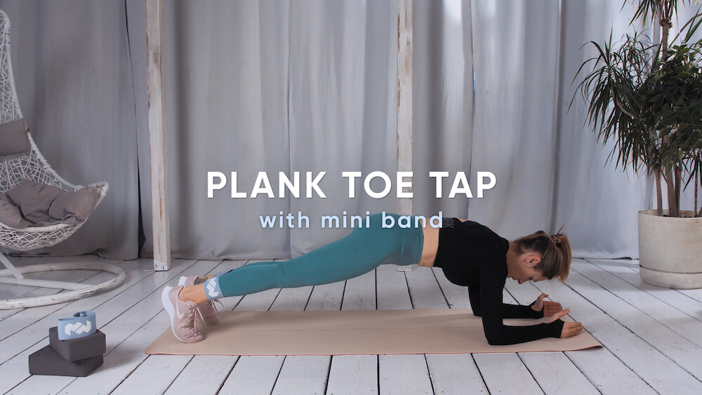 Plank toe tap with mini band