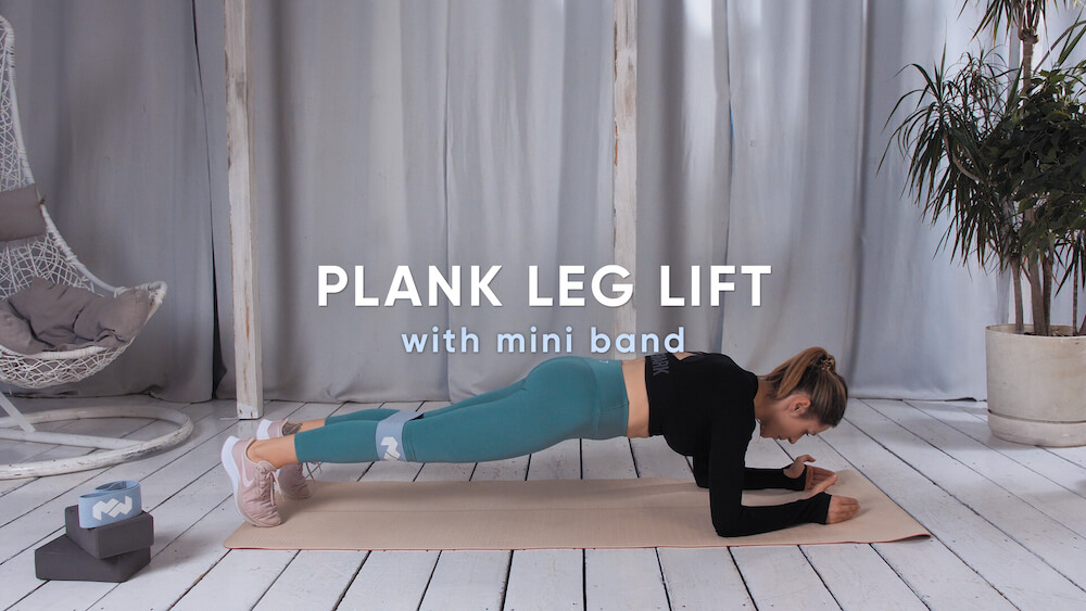 Plank leg lift with mini band