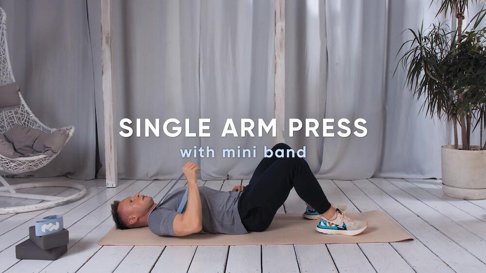 Single arm press with mini band
