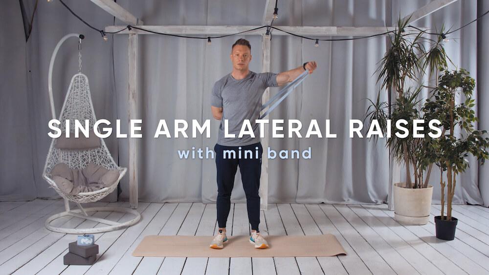 Single arm lateral raises with mini band