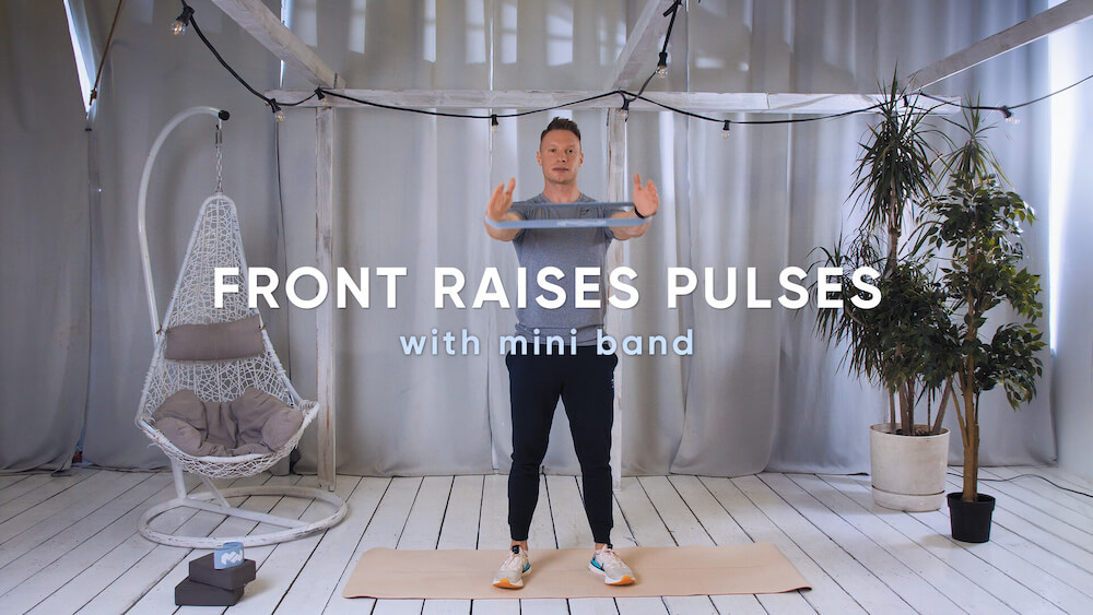 Front raises pulses with mini band
