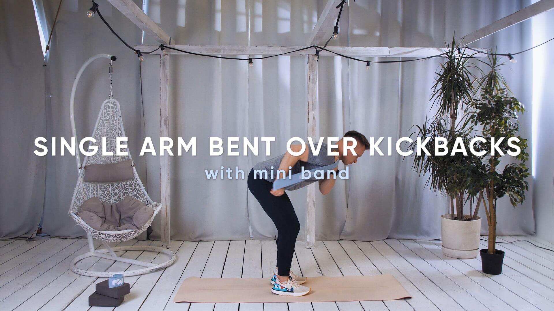 Single arm bent over kickbacks with mini band