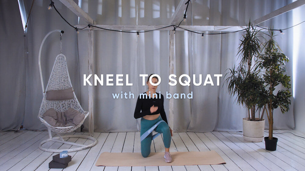 Kneel to squat with mini band