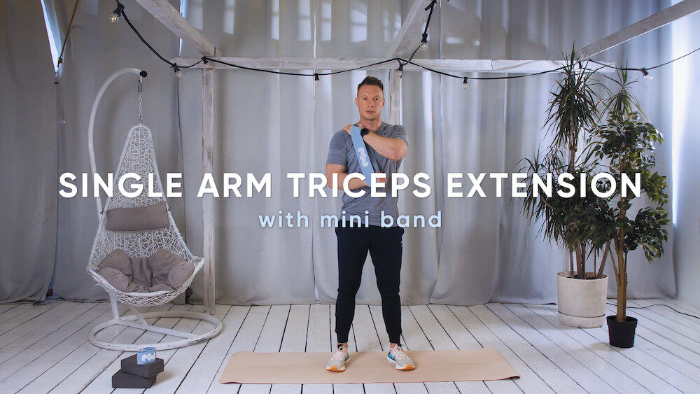 Single arm triceps extension with mini band