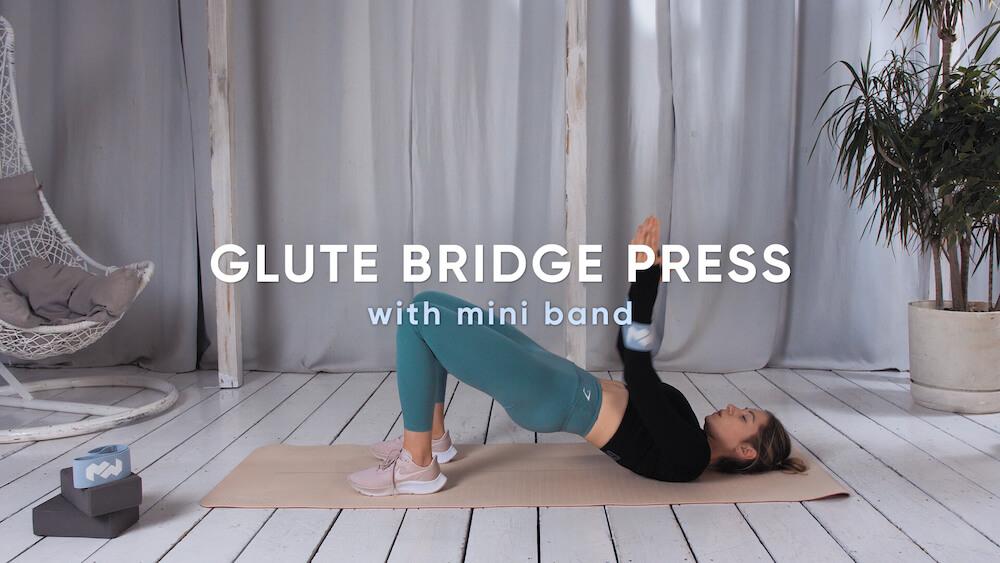 Glute bridge press with mini band