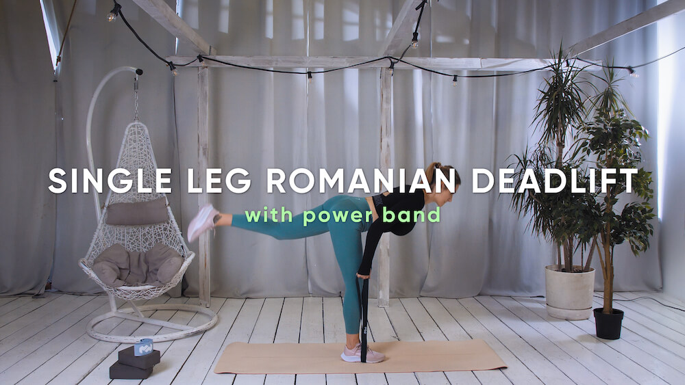 Single leg romanian deadlift with power band