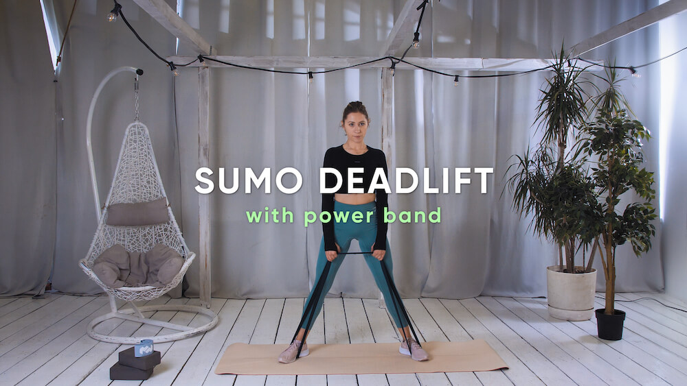 Sumo deadlift with power band