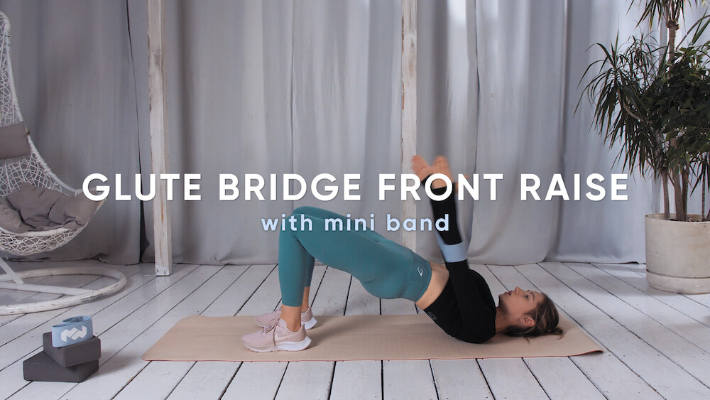 Glute bridge front raise with mini band