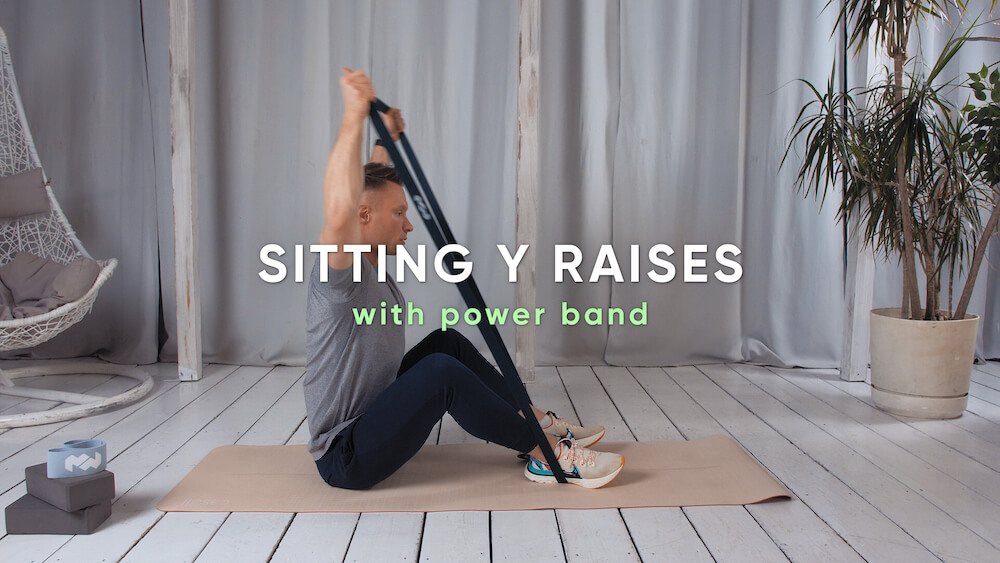 Sitting Y raises with power band