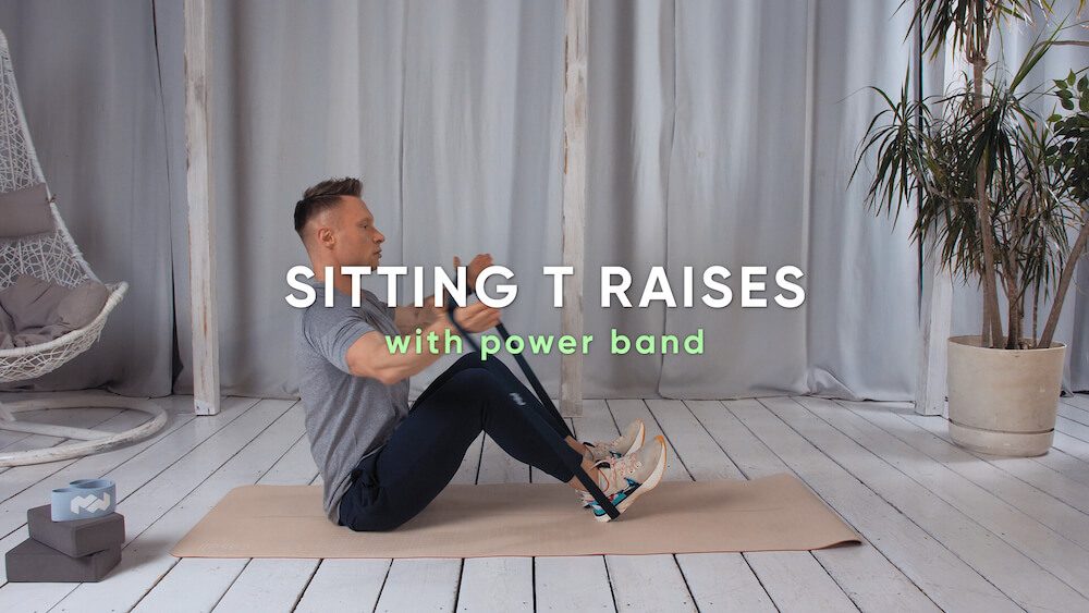 Sitting T raises with power band